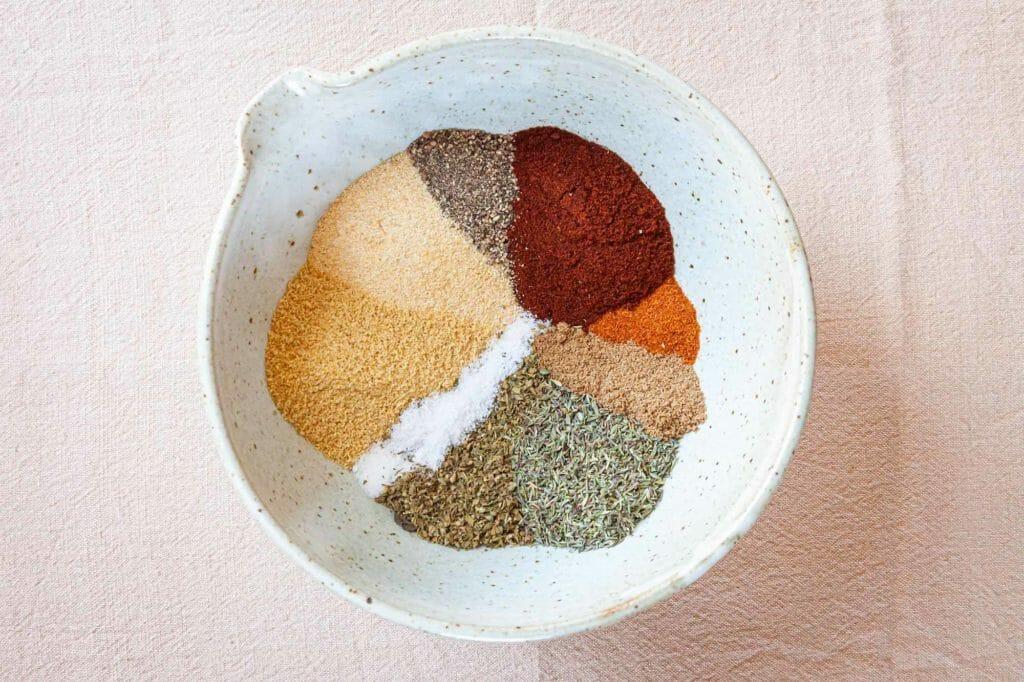 Chicken spice rub recipe - mix of spices in bowl