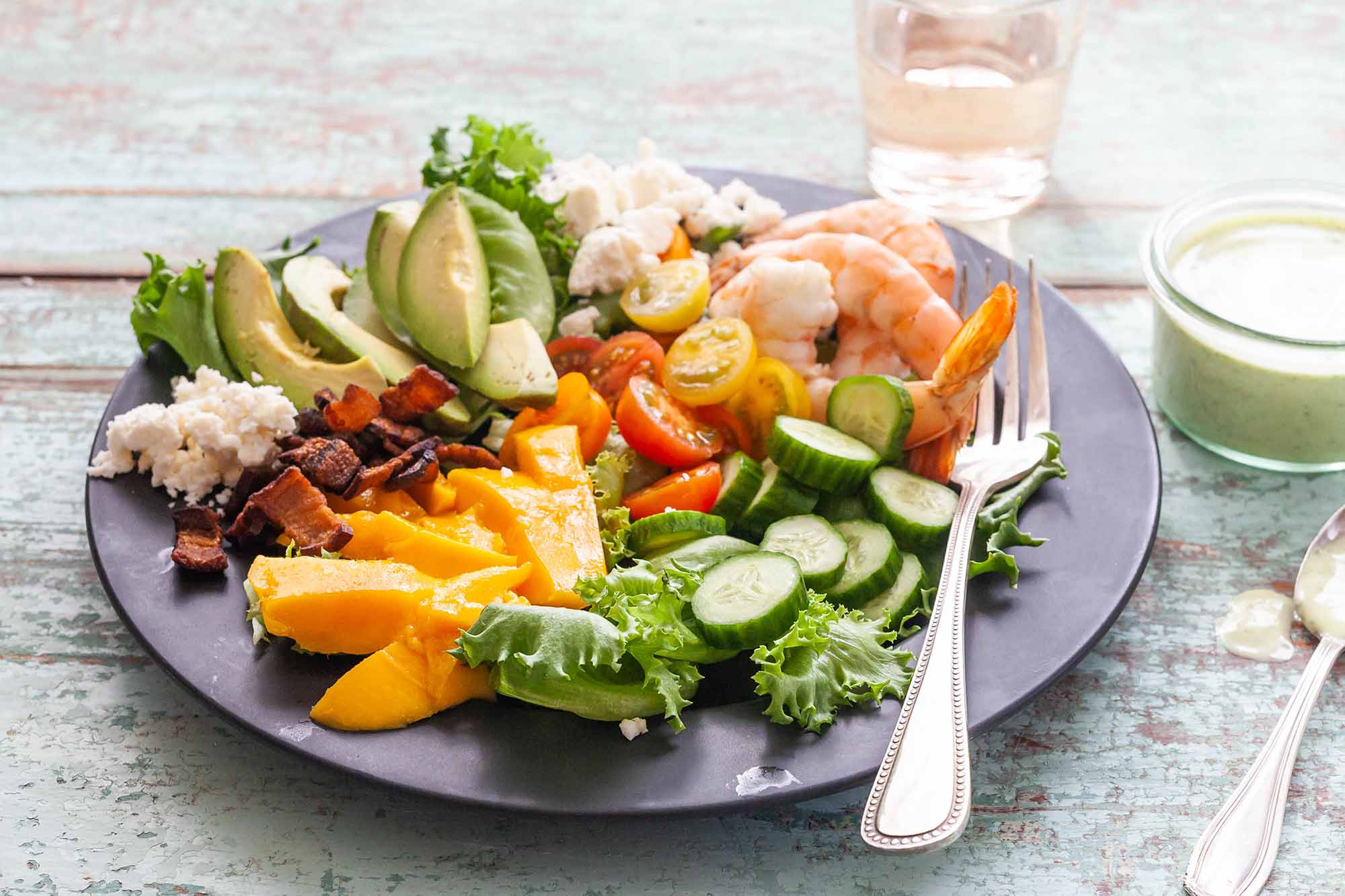 Cobb Salad with Shrimp and Mango - - shrimp and vegetables on gray plate with glass of rose