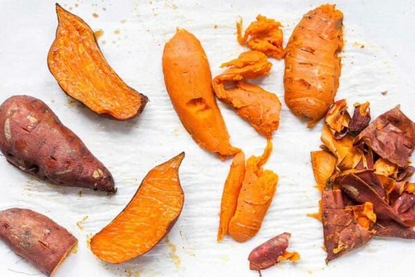 Sweet potatoes sliced open and roasted to make sweet potato pie.