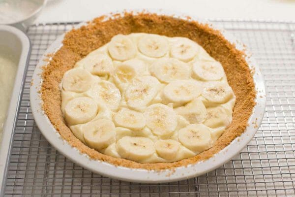 Homemade Banana Cream Pie with banana slices layered ontop of the pudding in a vanilla waffer crust.