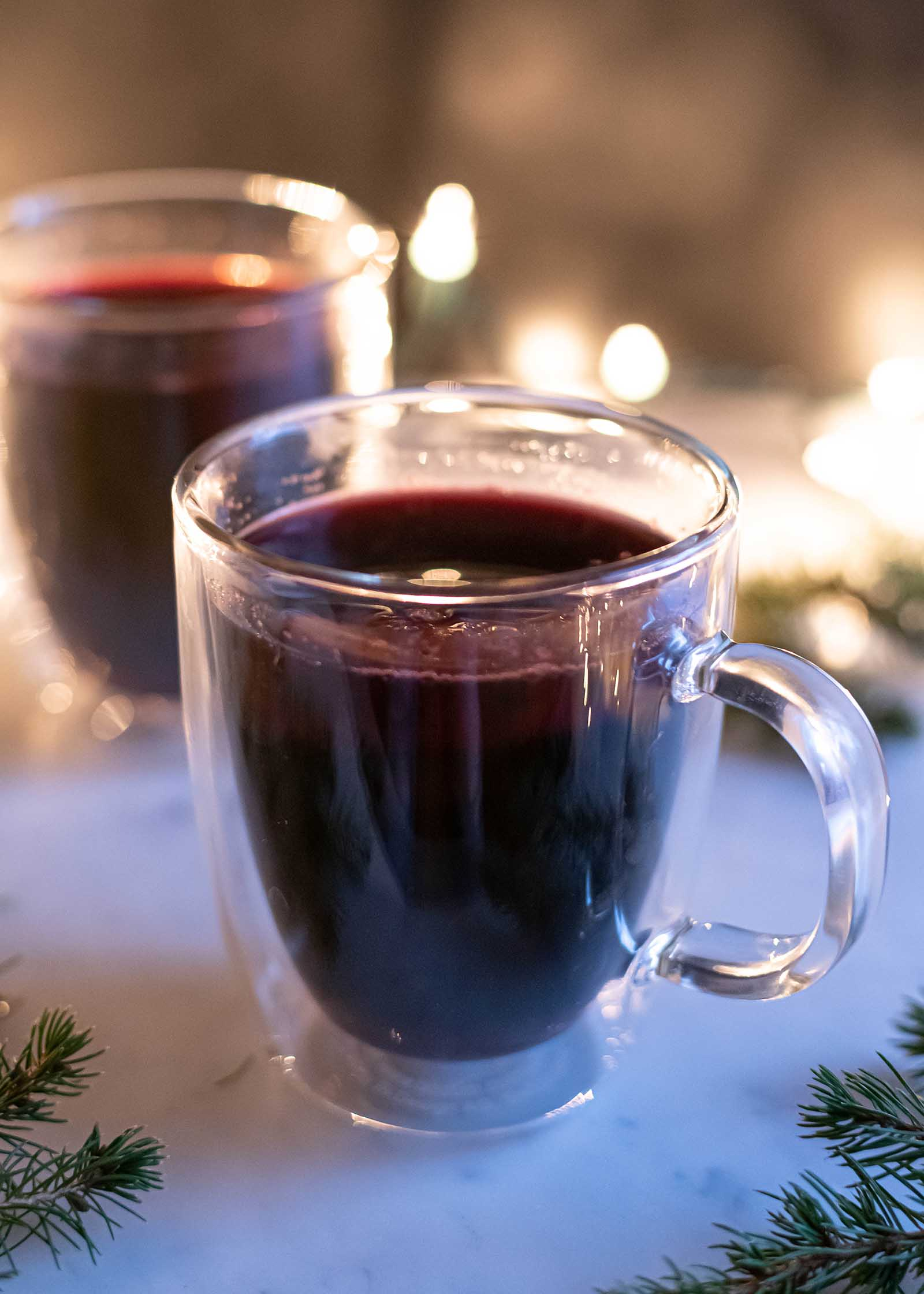 Mulled wine in glass mug with brandy