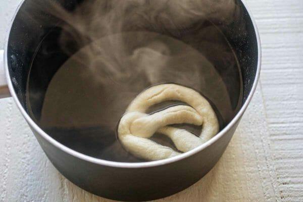 Boil pretzels for mini garlic butter pretzels recipe