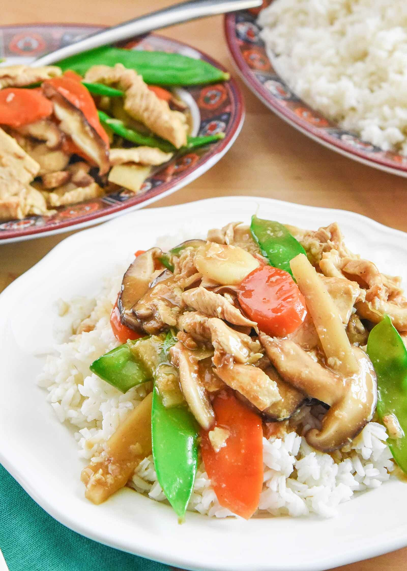 Moo Goo Gai Pan Chinese Food on a white plate with a platter
