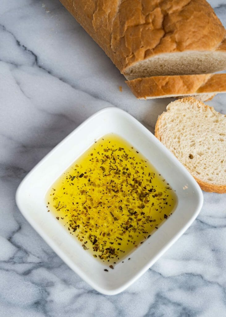 Olive oil with salt pepper and bread