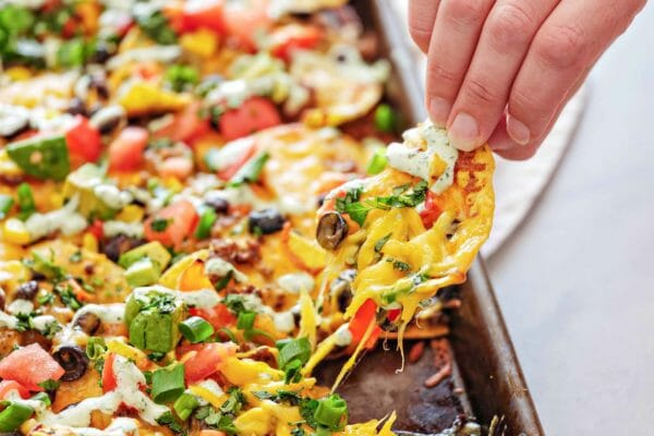Pulling a loaded chip away from a sheet pan of nachos