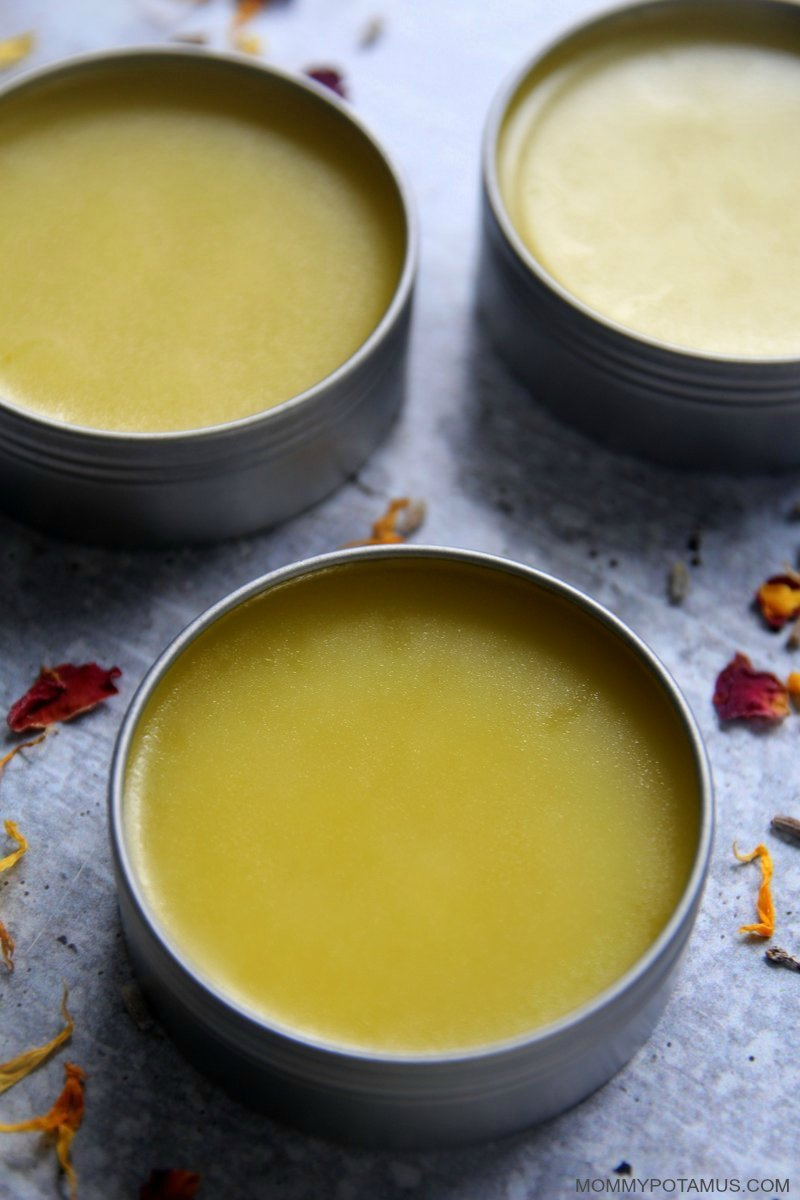 Overhead view of homemade hand salve in round metal tins