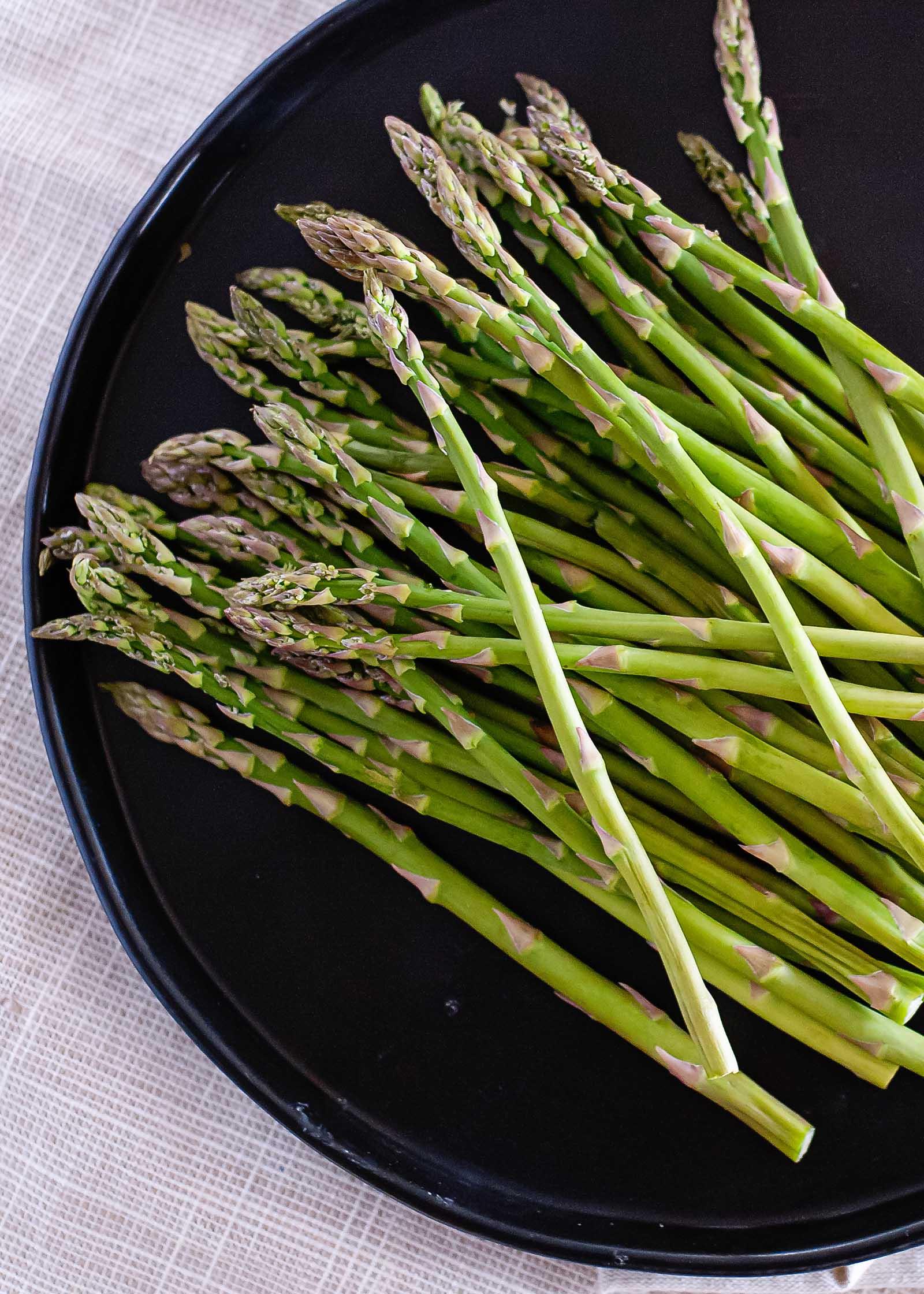 asparagus on black plate