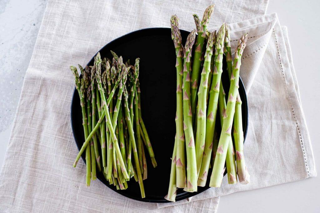 thick asparagus next to thin asparagus