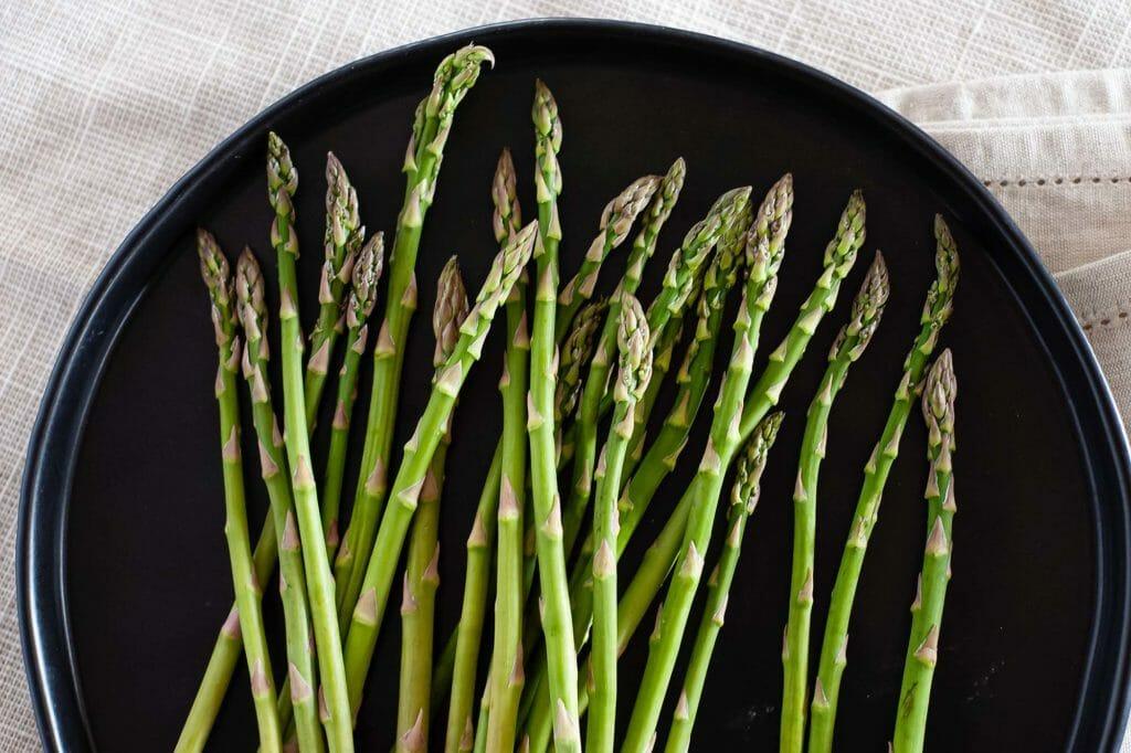 asparagus on a black plate
