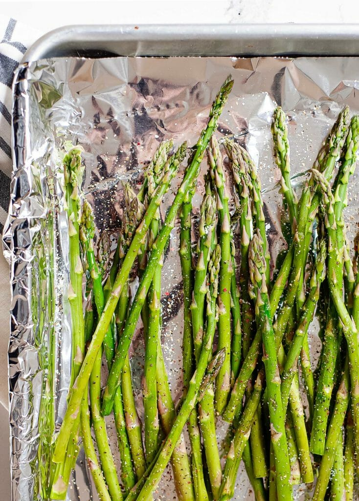 roasting asparagus on a baking sheet