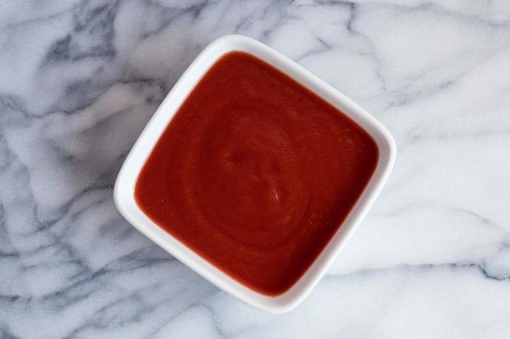 Tomato sauce in a white bowl