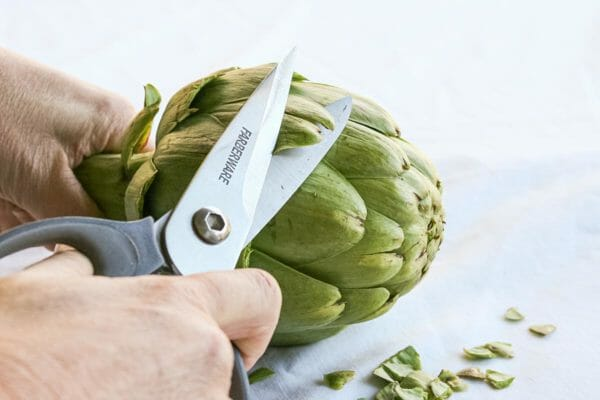 Cut off the tips of the artichoke leaves before steaming.