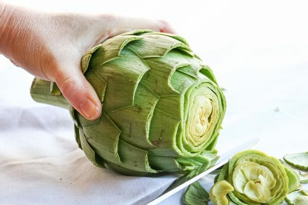 Slice off the top of the artichoke before steaming using a serrated bread knife