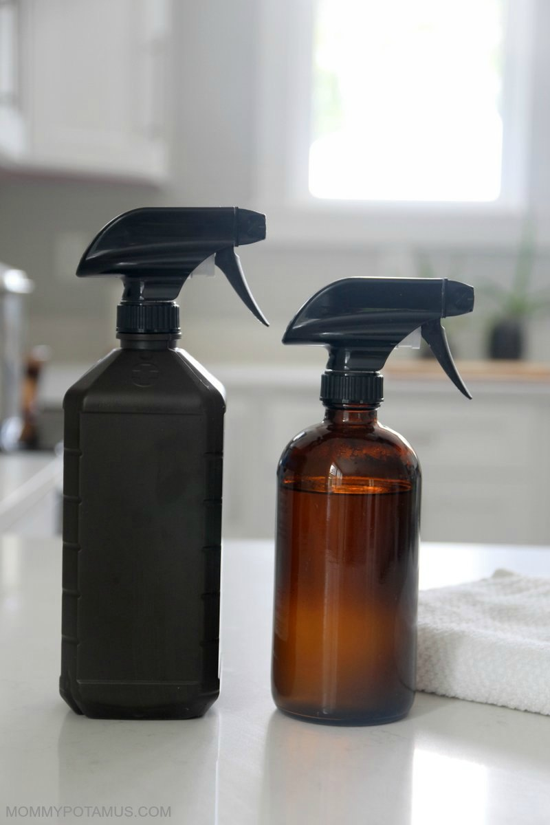 Two spray bottles - one filled with hydrogen peroxide and the other vinegar