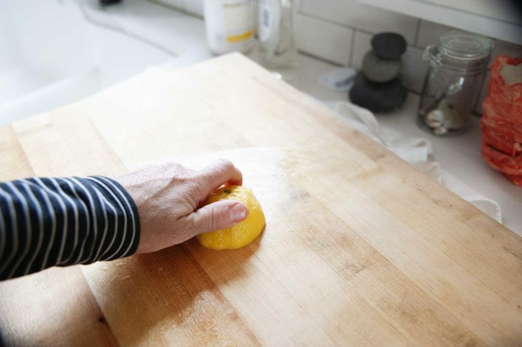 Clean wood cutting board with lemon