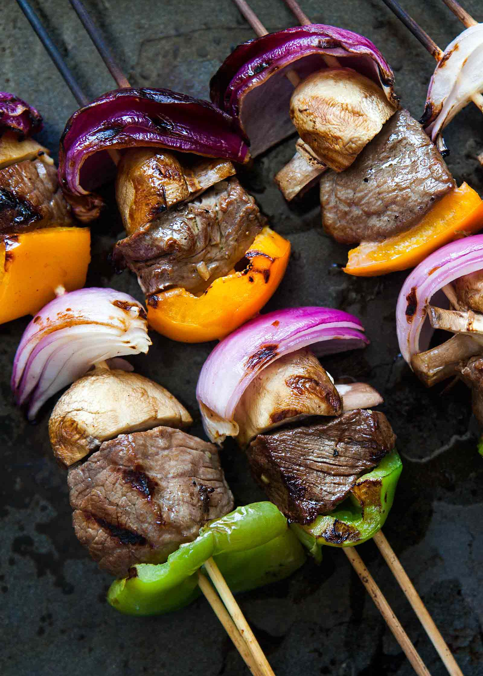 Beef Kabobs with onions, mushrooms, and bell peppers on skewers