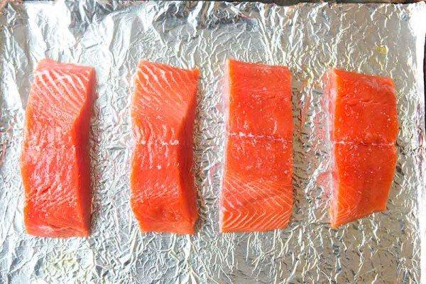 raw salmon on the sheet pan