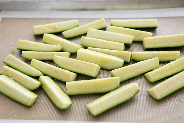 Arrange the zucchini on a baking sheet, skin side down